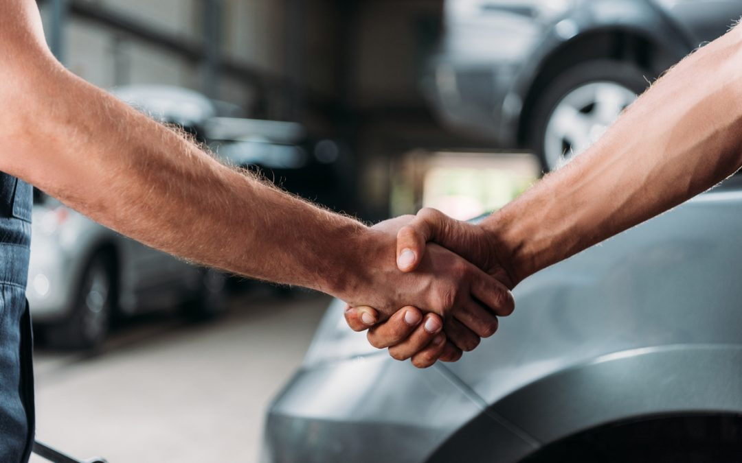 mechanics-shaking-hands-in-auto-repair-shop