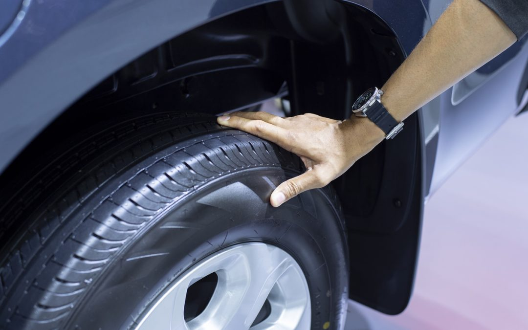 person-checking-tyres